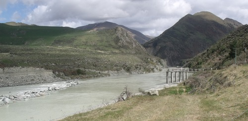 The Rangitata Diversion Race (RDR) intake. The stone wall in the Rangitata river diverts water to the intake (under the concrete columns. The water travels along a concrete tunnel (just visible) to the start of the RDR.