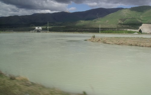 RDR sand trap. A bend and widening in the race causes the water to slow and drop much of the sand in the bend. Every day or so the sluice gate (visible top-right) is opened to flush the sand back to the Rangitata. Less the sand in the water means less wear on pumps and the power station that use the water.